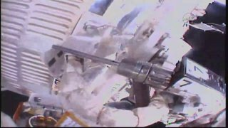 Two Humans Spacewalk Outside of the International Space Station